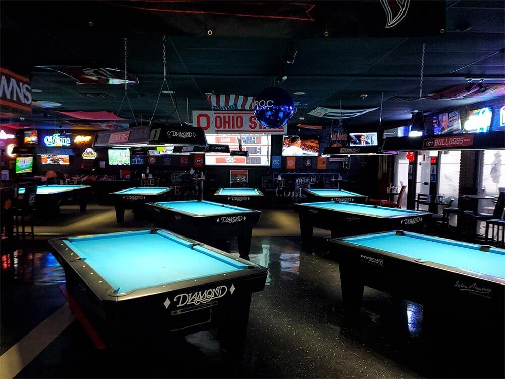 line of pool tables in bar